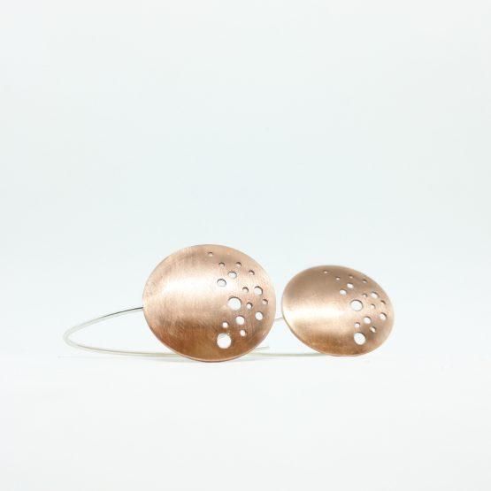 Pendientes de cobre y plata con diseño geométrico