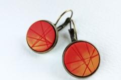 Pendiente de arcilla polimerica  en tonos rojos y naranja