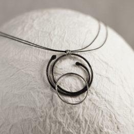 Colgante plata orbitas